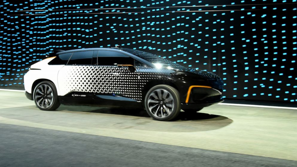 Faraday Future's FF 91 prototype electric crossover vehicle is shown during a speed test as it is unveiled during a press event for CES 2017 at The Pavilions at Las Vegas Market, Jan. 3, 2017 in Las Vegas.