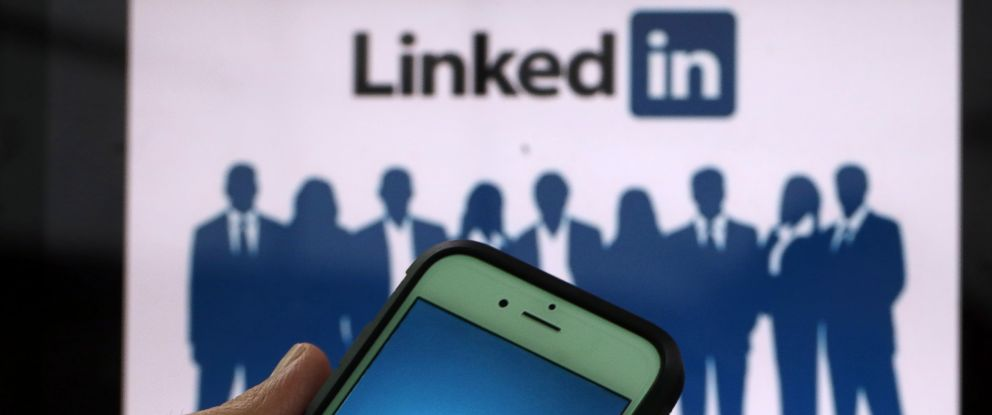 PHOTO: The LinkedIn Corp. logo is displayed on the screens of an Apple Inc. iPhone 6 and a laptop in this arranged photograph taken, May, 15, 2015, in London.