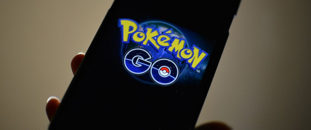 PHOTO: The logo of Pokemon GO is pictured on a smartphone in this photo illustration taken in Tokyo July 15, 2016.