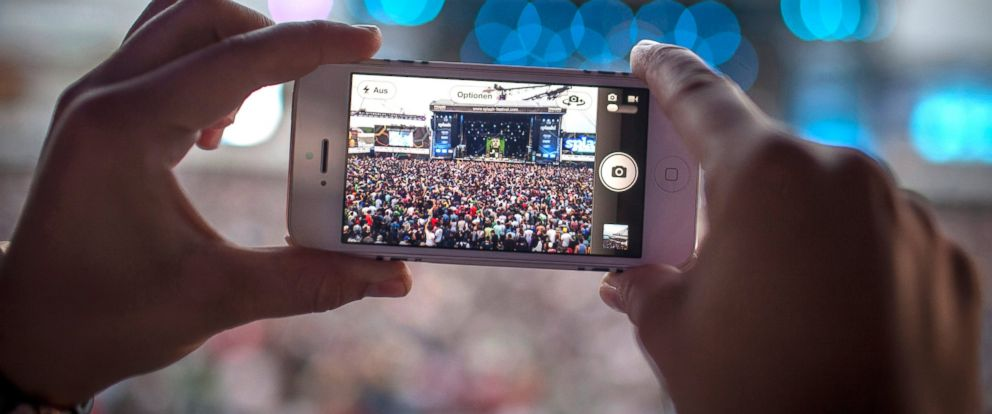 PHOTO: A fan is taking a picture with his iPhone mobile camera at a Tyler, The Creator concert in Germany, 2013.