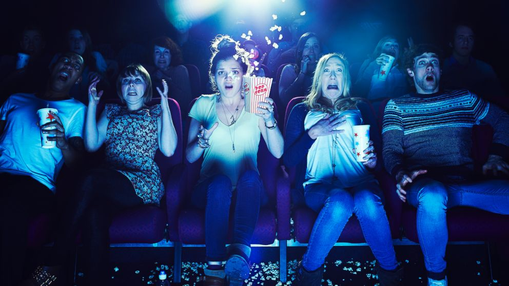 People enjoy a horror film in this undated file photo.