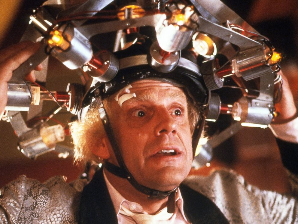 PHOTO: Christopher Lloyd wearing concoction on his head in a scene from the film Back To The Future, 1985.