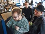 PHOTO: Curtis Machek, left, uses the worlds first bitcoin ATM at Waves Coffee House, Oct. 29, 2013, in Vancouver, British Columbia.