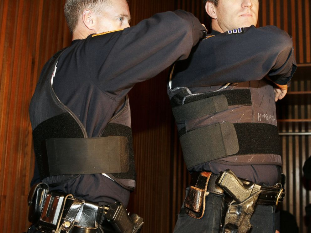 PHOTO: Sgt. John Kirrane, right, models the new NYPD vest with added protection on the sides with overlapping Kevlar.