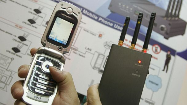 PHOTO: In this file photo, a trade exhibitor shows a portable pocket-sized cell phone jammer CPB-2000P at the CommunicAsia 2006 exhibition in Singapore on Jun. 21, 2006.