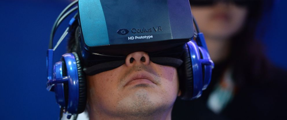 PHOTO: An attendee wears an Oculus Rift HD virtual reality head-mounted display as he plays EVE: Valkyrie, a multiplayer virtual reality game, at the Intel booth at the 2014 International CES, Jan. 9, 2014 in Las Vegas, Nevada.