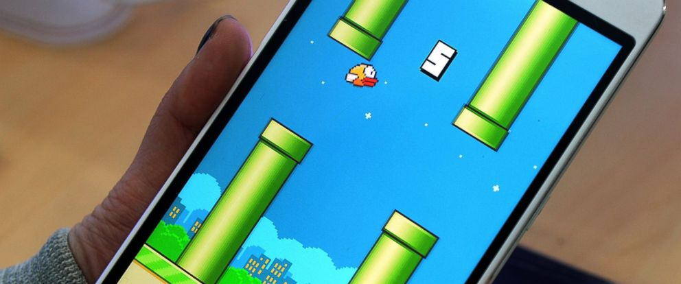 PHOTO: An employee plays the game Flappy Bird on a smartphone in Hanoi, Feb. 10, 2014.