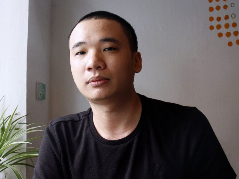 PHOTO: Nguyen Ha Dong, the author of the game Flappy Bird, relaxes inside a coffee shop in Hanoi, Vietnam, Feb. 5, 2014.