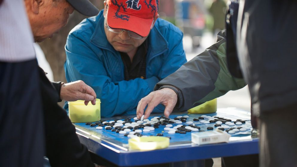People play the game of Go in Ditan Park, April 4, 2014 in Beijing.