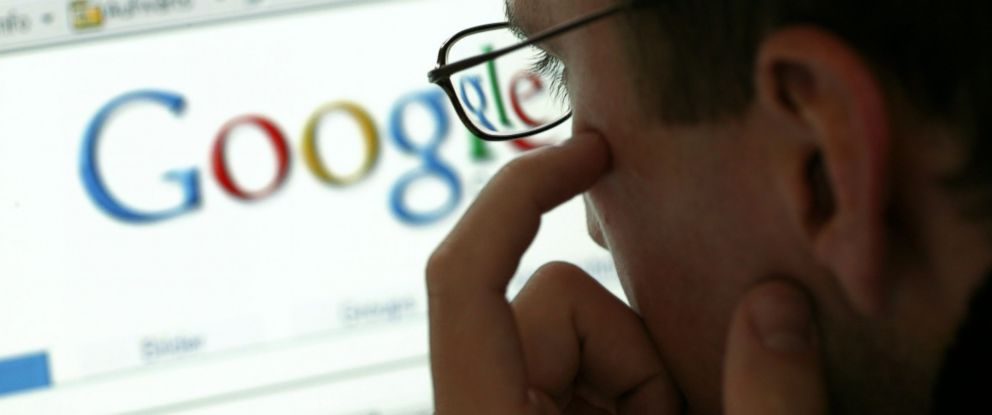PHOTO: A man is seen in front of a display with the website of the internet search engine Google in this undated file photo.