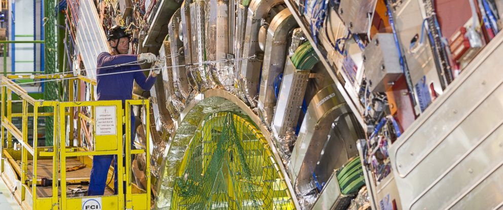 PHOTO: A technician works on the CMS detector, part of the CERN LHC experiment in Geneva