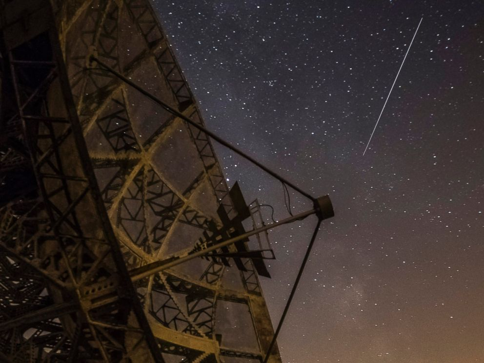 PHOTO: A Perseid meteor streaks across the sky above the radar near the Astronomical Institute of the Academy of Science of the Czech Republic, Aug. 12, 2015 in Ondrejov, Czech Republic.