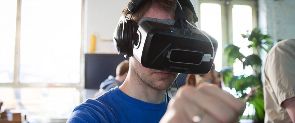PHOTO: A video gaming fan play games with a Oculus Rift Head-Mounted Display at the Gamefest during the International Games Week Berlin trade fair, April 23, 2015, in Berlin.