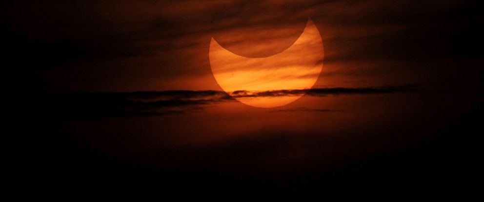 PHOTO: A partial solar eclipse as seen during sunrise in the coastal town of Gumaca, Philippines, May 21, 2012.