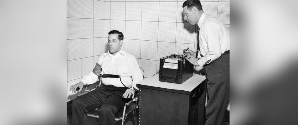 PHOTO: American inventor John Larson (1892 - 1983) at right, demonstrates the operation of a polygraph or lie detector at Northwestern University, Evanston, Ill., 1930s.