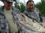 PHOTO: In this file photo, Russian President Vladimir Putin, left, inspects a pike fish he caught on Jul. 20, 2013 in the Tyva region of Russia.