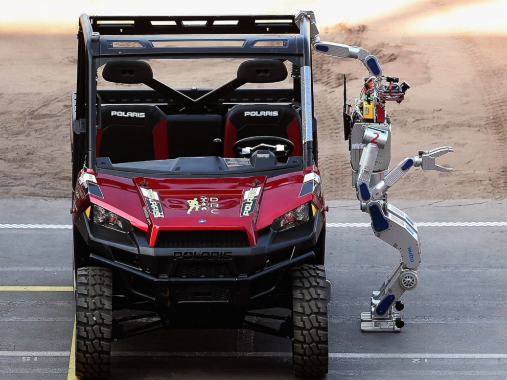 PHOTO: The Team Kaist HUBO robot from South Korea climbs out of a Polairs vehicle during the first day of the Defense Advanced Research Projects Agency (DARPA) Robotics Challenge at the Fairplex, June 5, 2015, in Pomona, Calif.