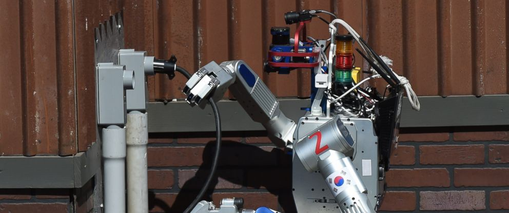 PHOTO: The humanoid robot DRC-Hubo developed by Team KAIST from South Korea completes a task before winning the finals of the DARPA Robotics Challenge at the Fairplex complex in Pomona, Calif., June 6, 2015.