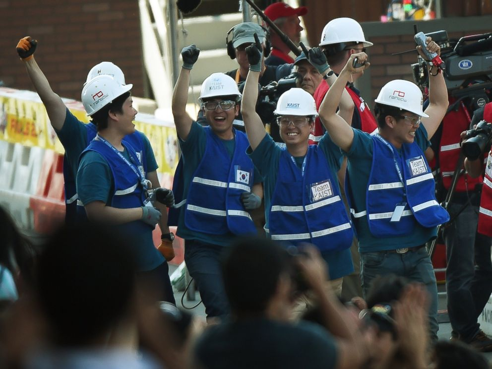 PHOTO: Members of the Team KAIST from South Korea celebrate after their robot DRC-Hubo won the finals of the DARPA Robotics Challenge at the Fairplex complex in Pomona, Calif., June 6, 2015.