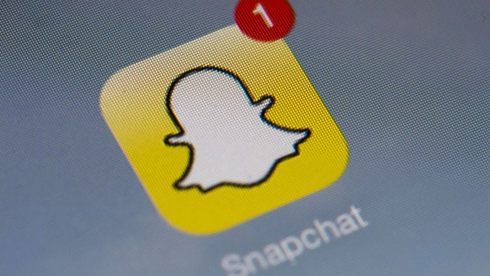 Snapchat's logo is displayed on a tablet on Jan. 2, 2014 in Paris.