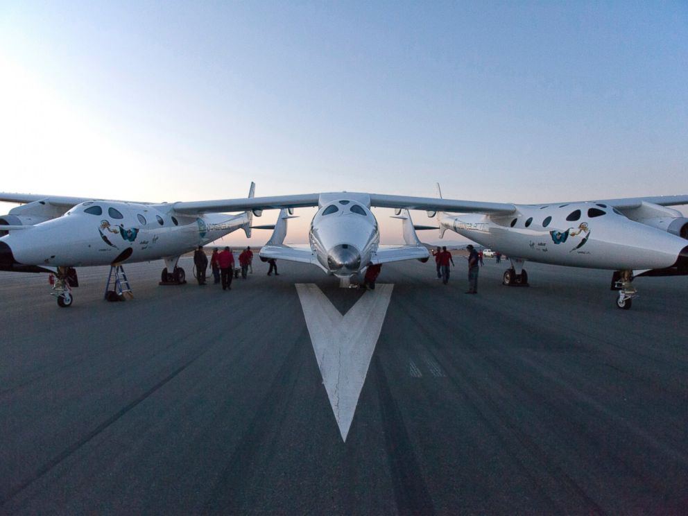 PHOTO: Virgin Galactic White Knight Two carries SpaceShipTwo for the first rocket powered flight (PF01) since the beginning of the program that began in 2005 in Mojave, Calif., April 29, 2013.