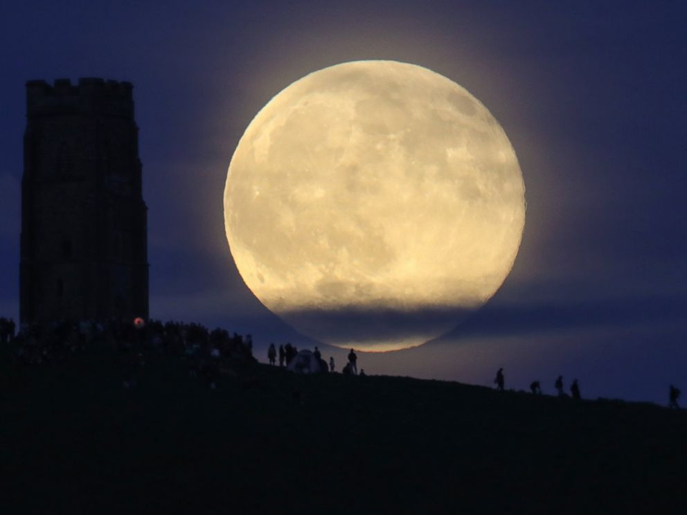 PHOTO: A full moon rises behind Glastonbury Tor as people gather to celebrate the summer solstice, June 20, 2016, in Somerset, England.