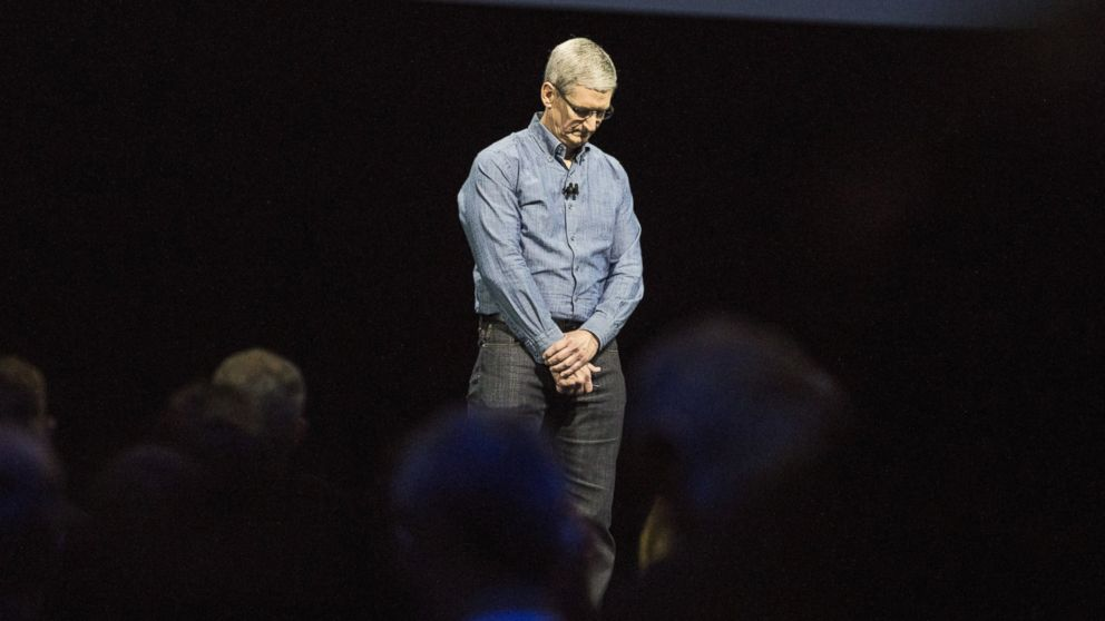 Apple CEO Tim Cook leads the audience in a moment of silence in tribute to the victims of the Orlando shooting at an Apple event at the Worldwide Developer's Conference, June 13, 2016, in San Francisco.