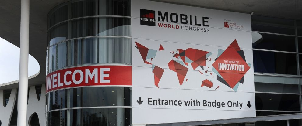 PHOTO: A person walks past a building entrance during final preparations for Mobile World congress in Barcelona, Feb. 25, 2015.