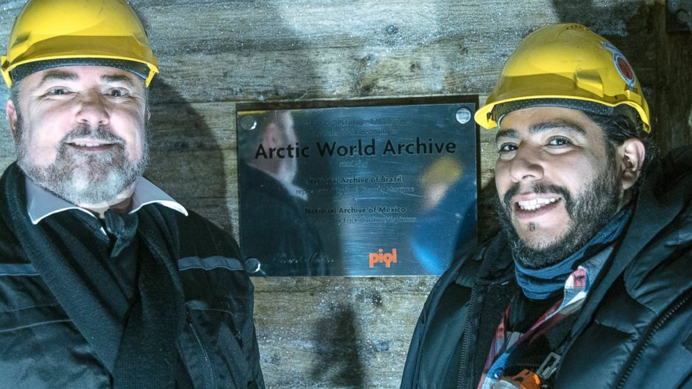 Ricardo Marques, Director, Brazil National Archives, and Erick Cardoso, Director of Information Technology, Mexican National Archives, in front of the inauguration plaquette of the Arctic World Archive at the entrance of the vault.