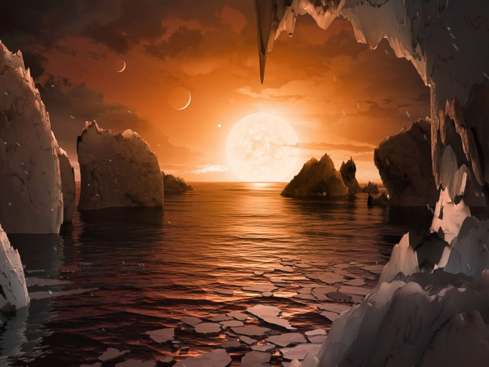 PHOTO: Imagine standing on the surface of the exoplanet TRAPPIST-1f. This artists concept is one interpretation of what it could look like.