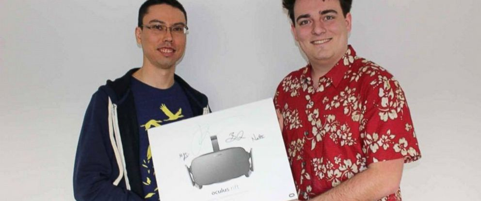 PHOTO: Palmer Luckey, the founder of Oculus, hand delivered a headset to Ross, an indie developer, who was the first person to pre-order the headset.
