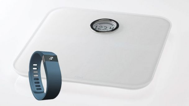 PHOTO: The Fitbit Force and Fitbit Aria scale.