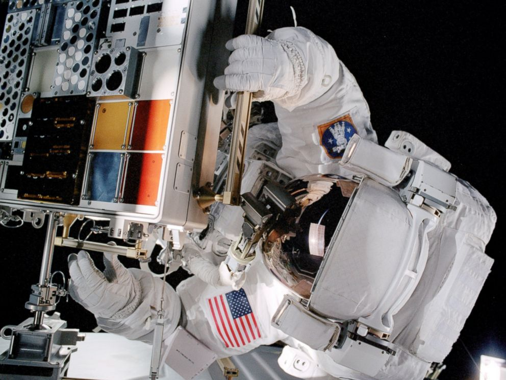 PHOTO: Patrick G. Forrester works with the Materials International Space Station Experiment (MISSE) during extravehicular activity in 2014.