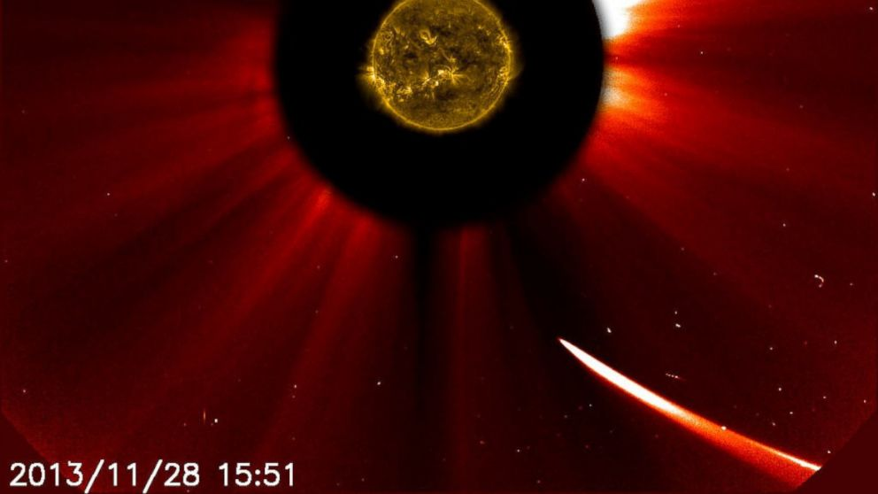 Comet ISON moves closer to the sun in this image composite with the sun imaged by NASA's Solar Dynamics Observatory in the center, and SOHO showing the solar atmosphere, the corona captured at 10:51 a.m. EST, Nov. 28, 2013.