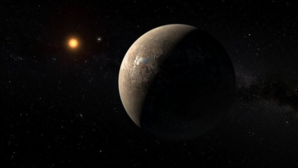 This artist's impression shows the planet Proxima b orbiting the red dwarf star Proxima Centauri, the closest star to the Solar System.