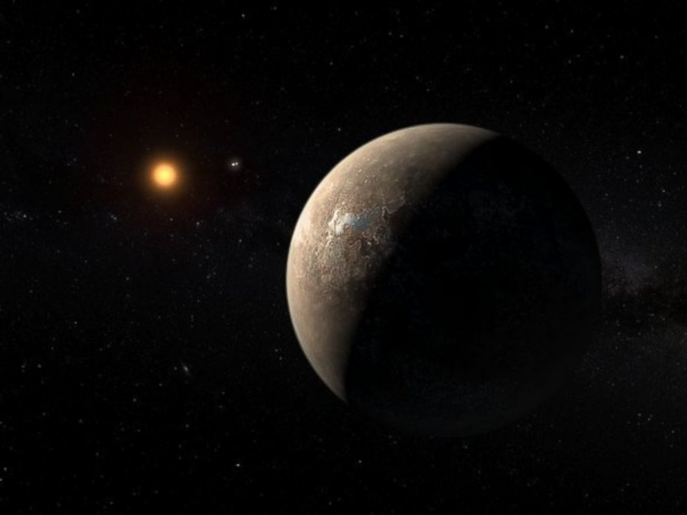 PHOTO: This artists impression shows the planet Proxima b orbiting the red dwarf star Proxima Centauri, the closest star to the Solar System.