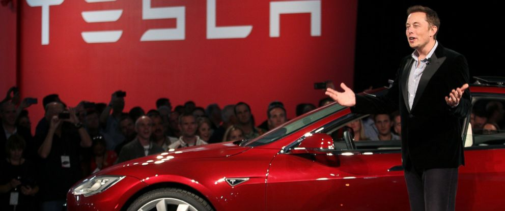 PHOTO: Tesla Motors CEO Elon Musk speaks next to the companys then newest Model S during the Model S Beta Event held at the Tesla factory in Fremont, Calif., Oct. 1, 2011.