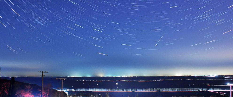 PHOTO: A meteor streaks past stars during the annual Quadrantid meteor shower in Qingdao, Shandong province, Jan. 4, 2014.