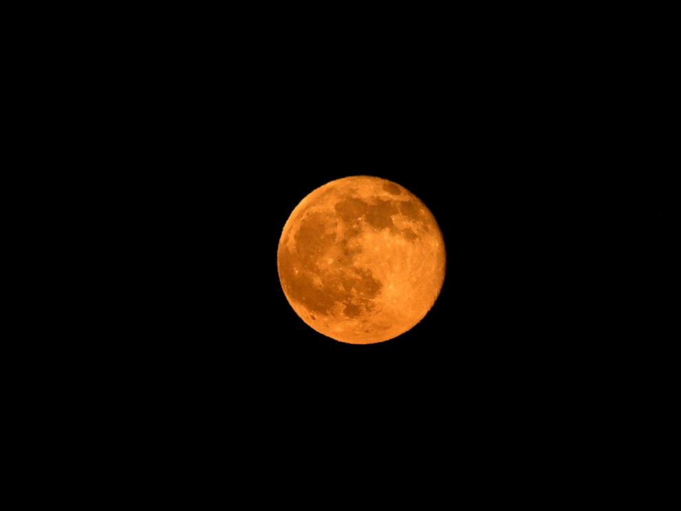 PHOTO: The Summer Solstice moon is shown through the haze of the so-called Fish Fire above Azusa, Calif. June 20, 2016.