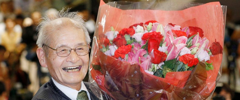 Akira Yoshino of Asahi Kasei Corporation poses with a bouquet of flowers in Tokyo Wednesday, Oct. 9, 2019, following an announcement that he was awarded the Nobel Prize in Chemistry. The prize went to John B. Goodenough of the University of Texas; M.
