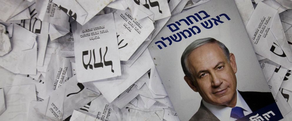 FILE - In this Wednesday, March 18, 2015 file photo, an election campaign poster with the image of Israeli Prime Minister Benjamin Netanyahu lies among ballot papers at his partys election headquarters, in Tel Aviv. Israels Shin Bet security servic