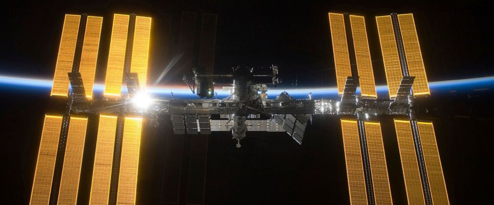 This March 25, 2009 photo provided by NASA shows the International Space Station seen from the Space Shuttle Discovery during separation. In the background is Earths atmosphere seen as a blue arc. On Tuesday, April 30, 2019, NASA announced that a ma