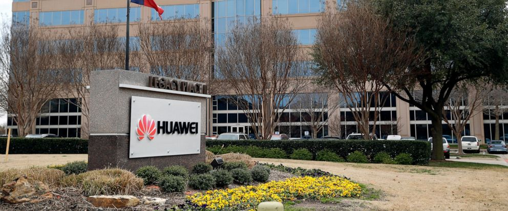 FILE - In this Thursday, March 7, 2019 file photo, the Texas state flag files outside the Huawei Technologies Ltd. business location in Plano, Texas. President Donald Trump issued an executive order Wednesday, May 15, 2019, apparently aimed at bannin