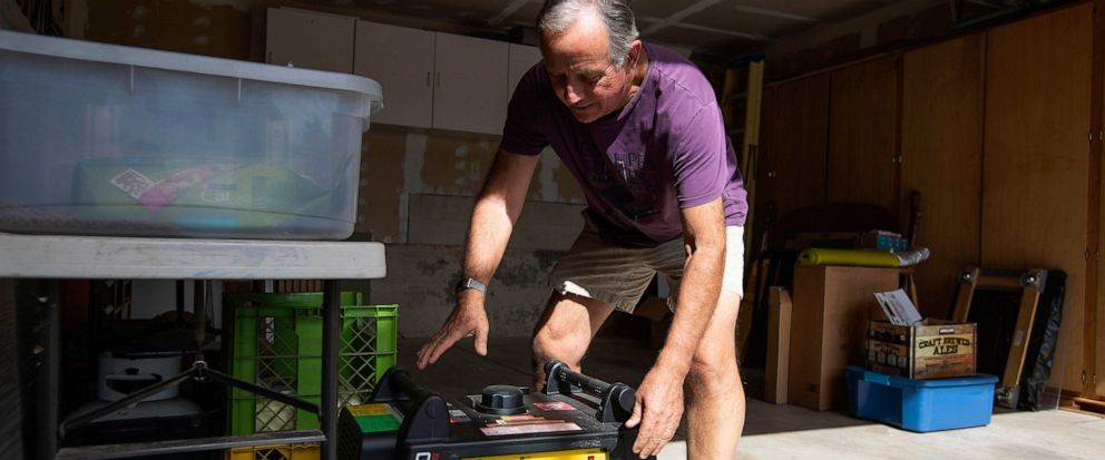 FILE - In this Tuesday, Oct. 8, 2019 file photo, Joe Wilson pulls his generator out in the garage of his home, which is in an area that is expected to lose power in the East Foothills area of San Jose, Calif. Power shutdowns intended to prevent more