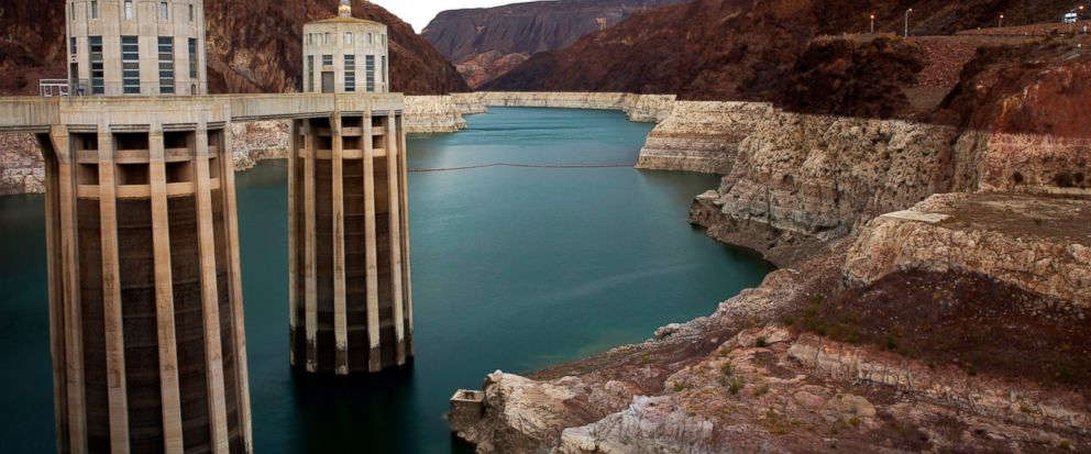 FILE - In this July 28, 2014, file photo, lightning strikes over Lake Mead near Hoover Dam that impounds Colorado River water at the Lake Mead National Recreation Area in Arizona. A major southern California utility is positioning itself to shoulder