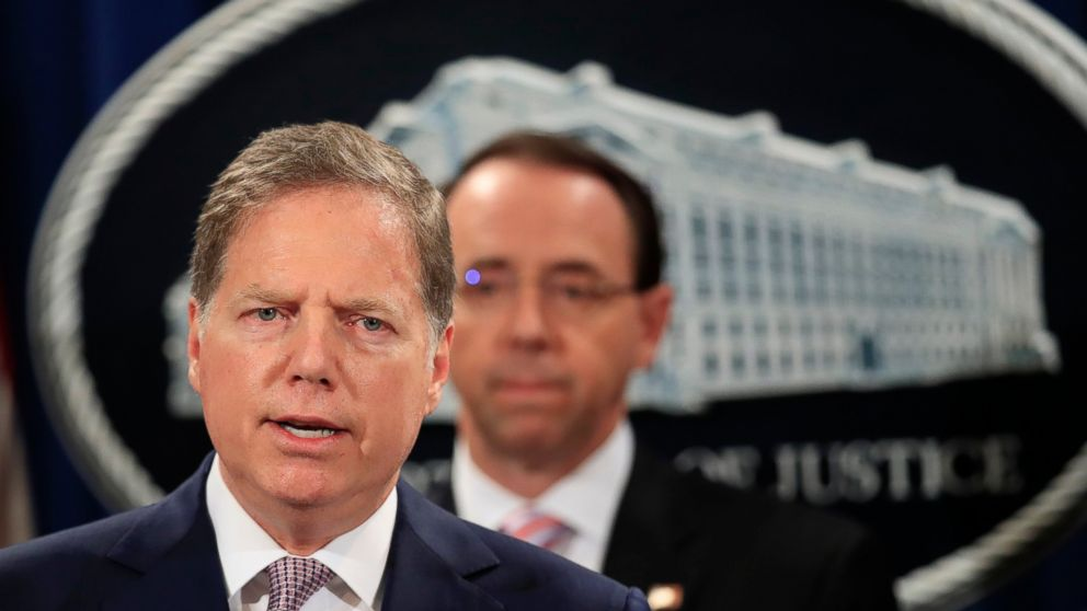 U.S. Attorney Geoffrey Berman from the Southern District of N.Y., center, with Deputy Attorney General Rod Rosenstein, speaks during a news conference at the Department of Justice in Washington, Thursday, Dec. 20, 2018. The Justice Department is charging two Chinese citizens with carrying out an extensive hacking campaign to steal data from U.S. companies. An indictment was unsealed Thursday against Zhu Hua and Zhang Shillong. Court papers filed in Manhattan federal court allege the hackers were able to breach the computers of more than 45 entities in 12 states. (AP Photo/Manuel Balce Ceneta)