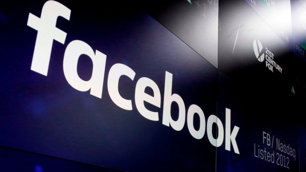 """FILE- In this March 29, 2018, file photo, the logo for Facebook appears on screens at the Nasdaq MarketSite in New York's Times Square. A report says Facebook and the Federal Trade Commission are negotiating a """"multibillion dollar"""" fine for the social network's privacy lapses. The Washington Post said Thursday, Feb. 14, 2019, that the fine would be the largest ever imposed on a tech company. Citing unnamed sources, it also said the two sides have not yet agreed on an exact amount. (AP Photo/Richard Drew, File)"""