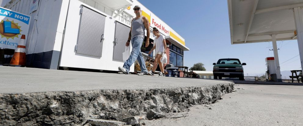 FILE - This July 6, 2019 photo shows crack in a gas stations driveway in the aftermath of an earthquake in Trona, Calif. Officials say Thursday, July 11, 2019, that two Southern California desert communities, Ridgecrest and Trona, struck by last wee