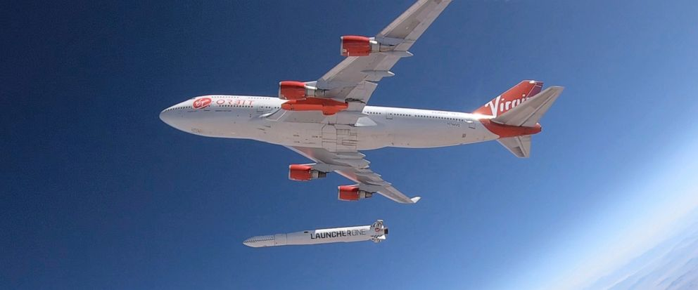 """In this photo provided by Virgin Orbit, a rocket is dropped from a Boeing 747 airplane flying above Edwards Air Force Base in California, Wednesday, July 10, 2019. The """"drop test,"""" which did not involve firing the rocket motor, was part of a test of"""