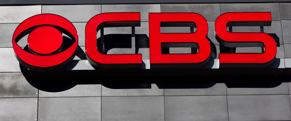 FILE - In this Feb. 13, 2012, file photo, a CBS logo is displayed on the exterior of CBS Scene Restaurant and Bar, at Gillette Stadium, in Foxborough, Mass. CBS and Viacom said Tuesday, Aug. 13, 2019, that they will reunite, bringing together their n